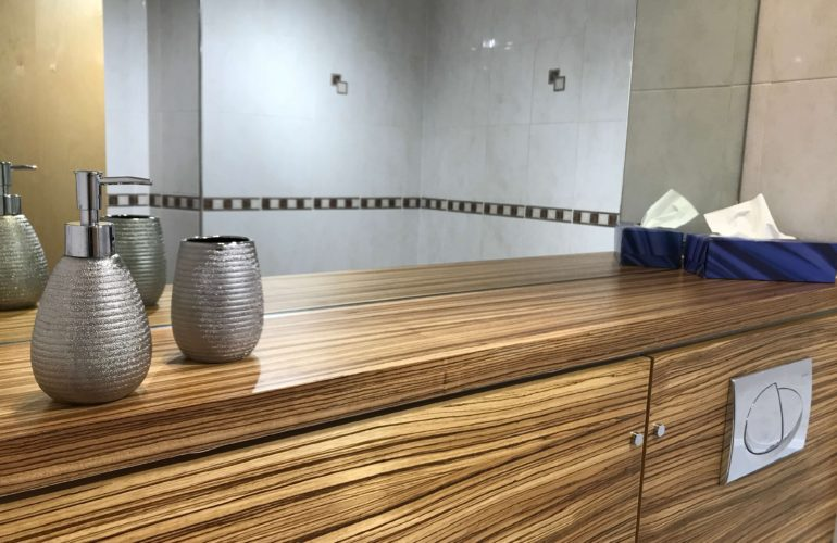 bathroom mirror and wood veneer