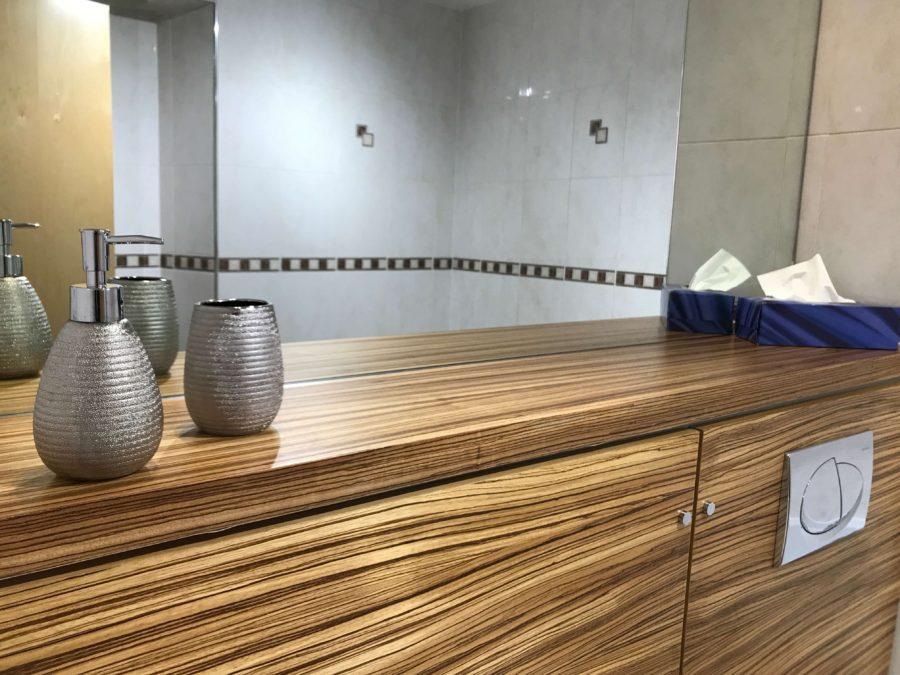 bathroom mirror and wood veneer